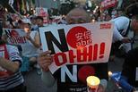 韩民众举行第4次集会 抗议日本\