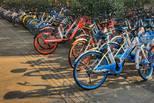 小藍摩拜齊漲價 共享單車燒錢難再續