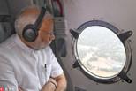 印度洪水致300亡 莫迪乘飞机视察灾区