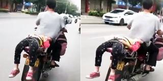 女儿哭闹厌学 父亲将其绑摩托车后座强送