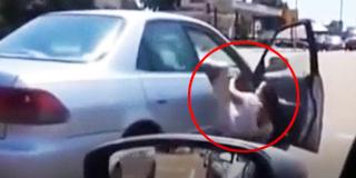 情侣吵架女子被一脚踹下车 惨遭拖行重摔