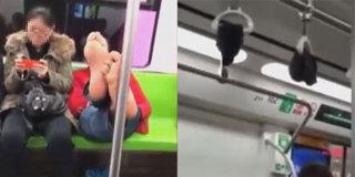 辣眼睛!男子地铁脱鞋光脚 吊环上晾袜子