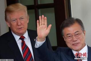 特朗普文在寅签新版美韩自贸协定