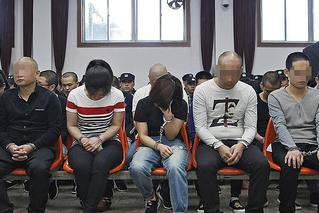 跨国诈骗案34名被告受审 审理超过8小时